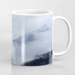 Mysterious fog rolling through layers of hills and mountains Coffee Mug