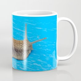 Snail crawling the green grass in garden Coffee Mug
