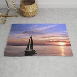 Sailing at sunset Rug