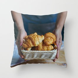 Croissant in a wicker basket Throw Pillow