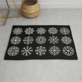minimalist snow flakes on black Rug