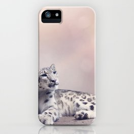 Young Snow leopard portrait resting on rock iPhone Case