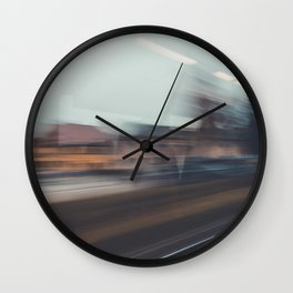 Long exposure photo of a train passing through the city Wall Clock