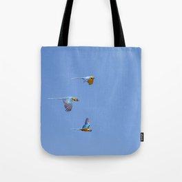Blue macaws flying under blue sky Tote Bag