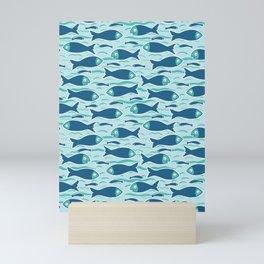 Cute shoal of fish swimming in sea water. Mini Art Print