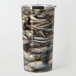 small silvery fish put on display to be sold. Fishes in the foreground and in the background unfocus Travel Mug