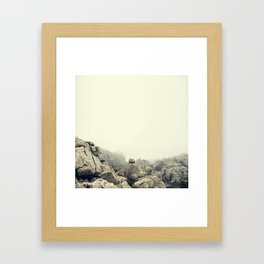 Misty rocks Framed Art Print