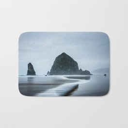 Incoming Waves Recede During Rainy Weather at Haystack Rock in Cannon Beach, Oregon Bath Mat