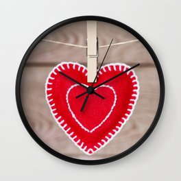 Clothesline with Valentine's Day heart decoration on a rustic background Wall Clock