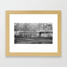 Lonely man by the lake Framed Art Print