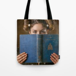 Girl Smiling Behind a Book Tote Bag