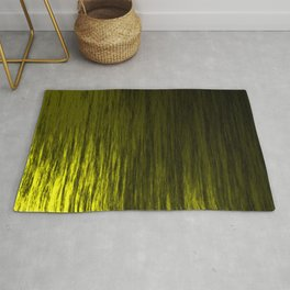 Bright texture of shiny foil of yellow flowing waves on a dark fabric. Rug
