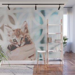 Cute Tabby Kitten In Hand Wall Mural