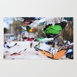 Colorful foam butterflies dangling in the air Rug