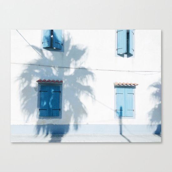 Blue windows and a palm Canvas Print
