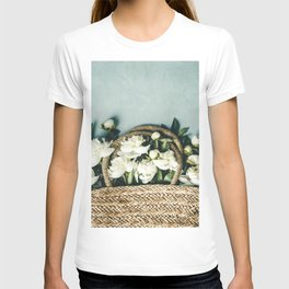 Beautiful peony flowers in straw bag over blue rustic background T-shirt