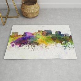 Arlington skyline in watercolor background Rug