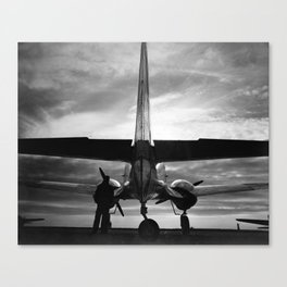 Airplane at sunrise Canvas Print