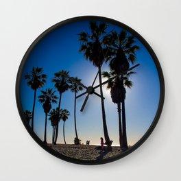 Sun on palm tree Wall Clock