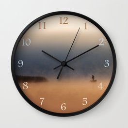 Fisher in foggy morning Wall Clock
