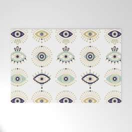 Evil Eye Collection on White Welcome Mat