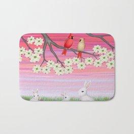 cardinals, dogwood blossoms, bunnies, & crocuses Bath Mat