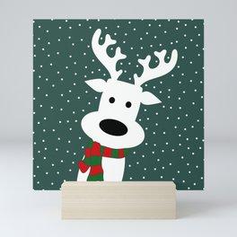 Reindeer in a snowy day (green) Mini Art Print