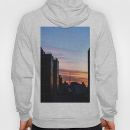 Beautiful sunrise in the city. Sunlight break down throughout the buildings and shine bright. Hoody