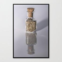 Tiny bottle of beach sand Canvas Print