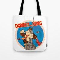 donkey kong Tote Bags featuring Donkey King Kong by Vickn