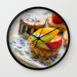Small fruit tarts laid out on an antique china plate Wall Clock