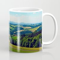 airplanes Mugs featuring Condensation trail with some scenery by Patrick Jobst