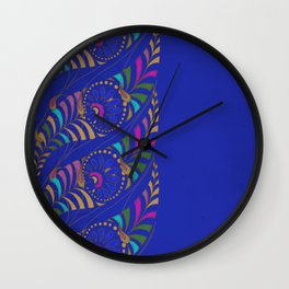 Caravan Ornamental Pattern:  Stylized feather or paisley in hot colors on indigo blue Wall Clock