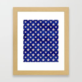 Gold stars on a dark blue background. Framed Art Print
