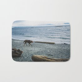 Pup on a beach Bath Mat