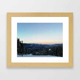 Snowboarding downhill at sunset Framed Art Print