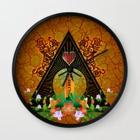surfboard Wall Clocks featuring Surfboard with flowers  by nicky2342