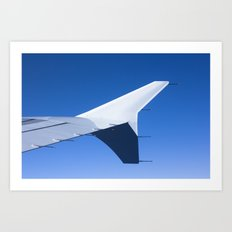 Airplane wing on a blue sky  Art Print