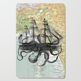 Octopus Attacks Ship on map background Cutting Board