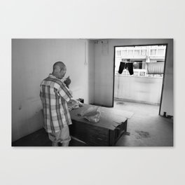 Portrait of a homeless man at home Canvas Print