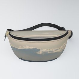 peak through white clouds Fanny Pack