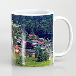 Green grass, the village and a transmitter pole Coffee Mug