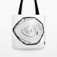 tree rings Tote Bags featuring Tree Rings by brittcorry