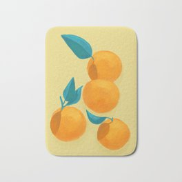 Oranges on yellow Bath Mat