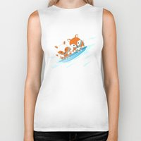 skiing Biker Tanks featuring Skiing by HK Chik