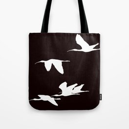 White Silhouette of Glossy Ibises In Flight Tote Bag