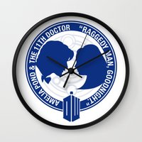 amy pond Wall Clocks featuring Doctor Who pals: Matt Smith & Amy Pond by logoloco