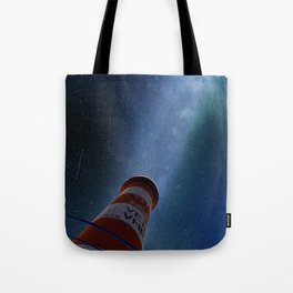 Lighthouse under starry sky Tote Bag