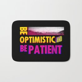 Be optimistic. Be patient. A PSA for stressed creatives Bath Mat