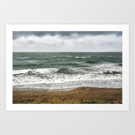 Land and sea under stormy clouds Art Print